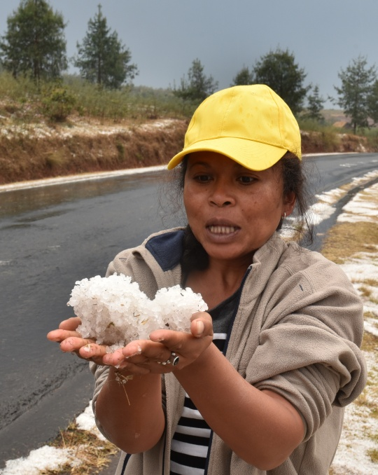 Nadia with a handful of hailstones
